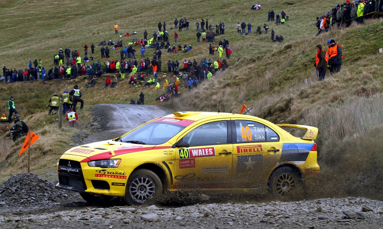 Ott Tanak (EST) Kuldar (EST), Mitsubishi Lancer Evo X, Pirelli Star Driver