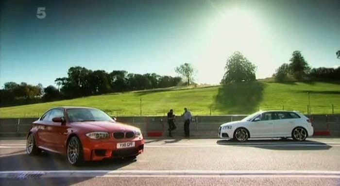 Fifth Gear compares the BMW 1M to the Audi RS3 with timed laps.