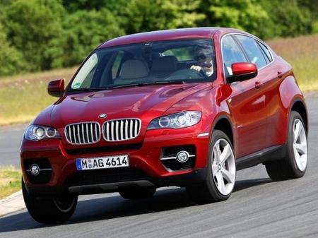 BMW X6 xDrive 50i vs Porsche Cayenne GTS, prueba en Nürburgring