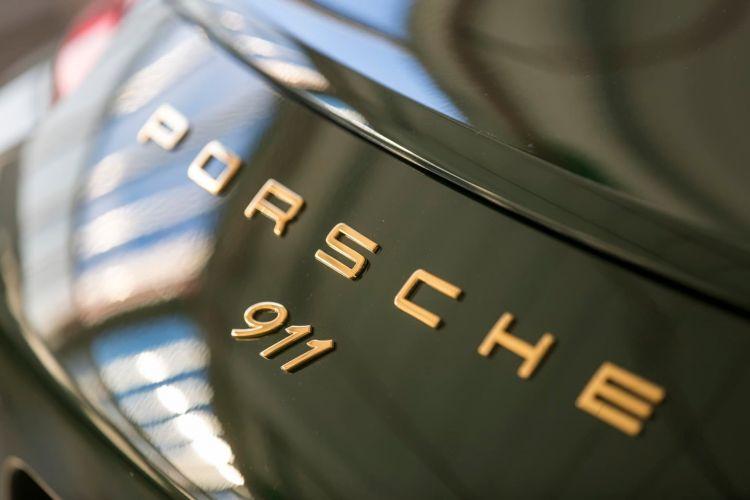 Investigacion Emesiones Porsche Gasolina 911 Logo